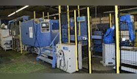 Verkettete Automatisierung einer Drehmaschine und Räummaschine